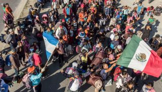 Central American migrants arrive in Tijuana, Mexico, on Thursday.