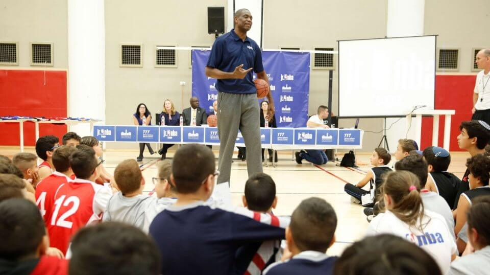 NBA Hall of Famer Dikembe Mutombo talks to kids during a workshop at the Sylvan Adams sports center at the YMCA In Jerusalem on Tuesday.