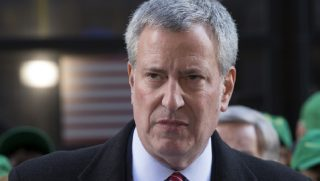 New York City Mayor Bill de Blasio is pictured speaking at a November 2017 rally against the GOP tax cuts.