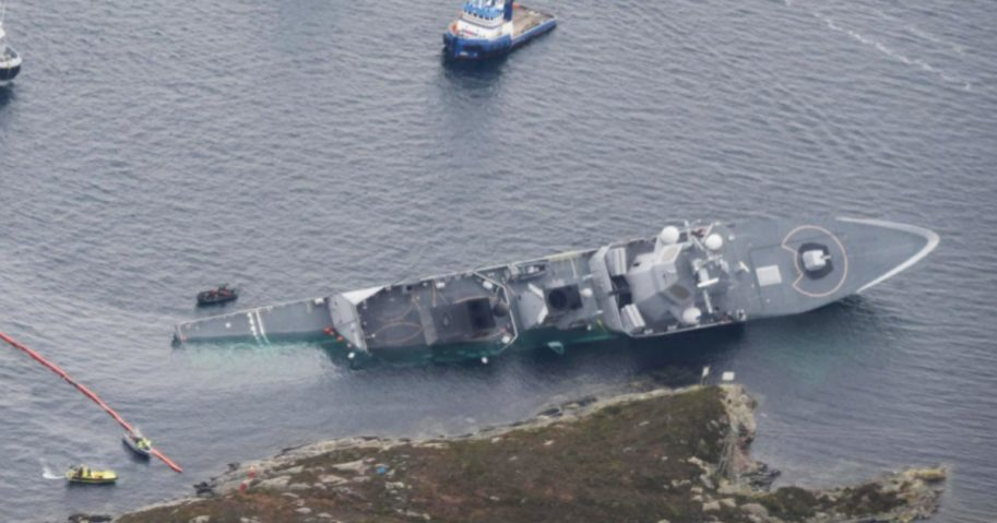 A Norwegian naval frigate that collided with an oil tanker was intentionally run aground by its captain to prevent it from sinking.