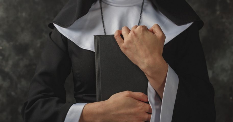 A nun holding a Bible
