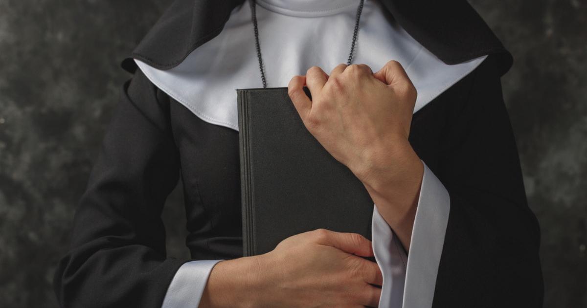A nun holding a Bible