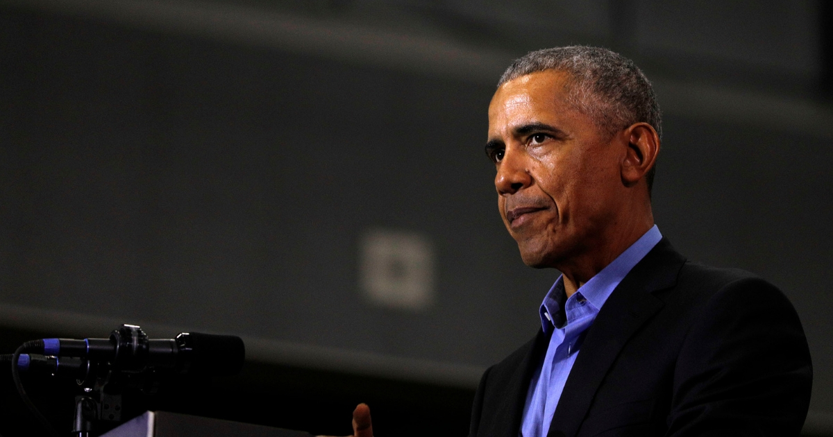 Former President Barack Obama speaks at a rally to support Michigan democratic candidates
