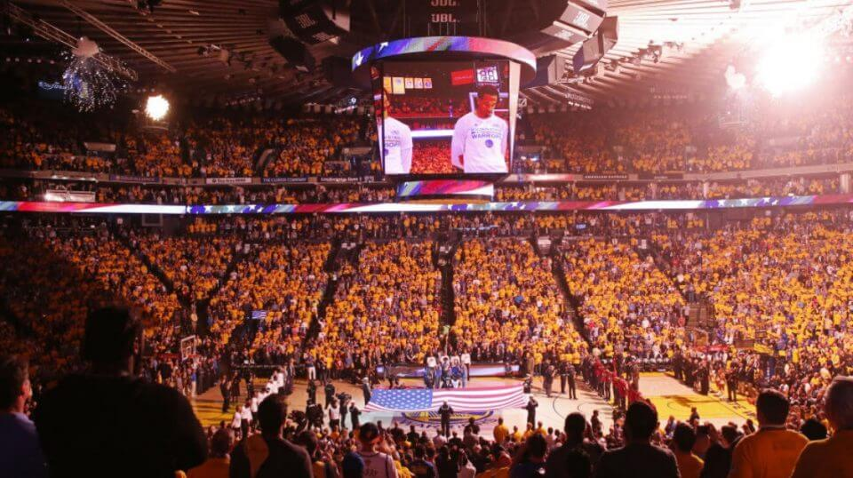 The crowd stands for the national anthem prior to an NBA game at Oracle Arena