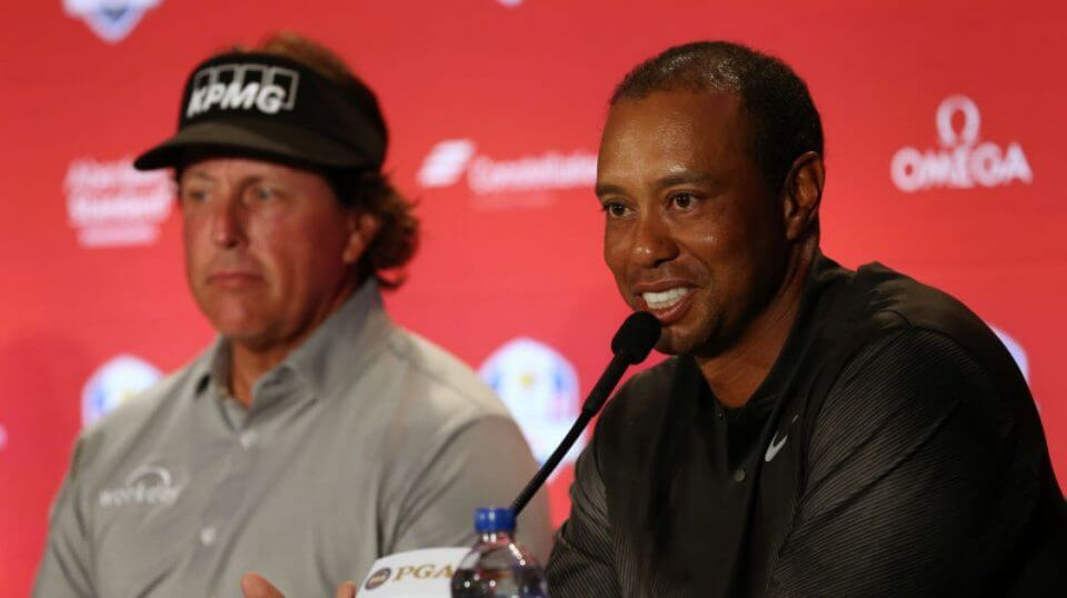 Phil Mickelson, left, and Tiger Woods