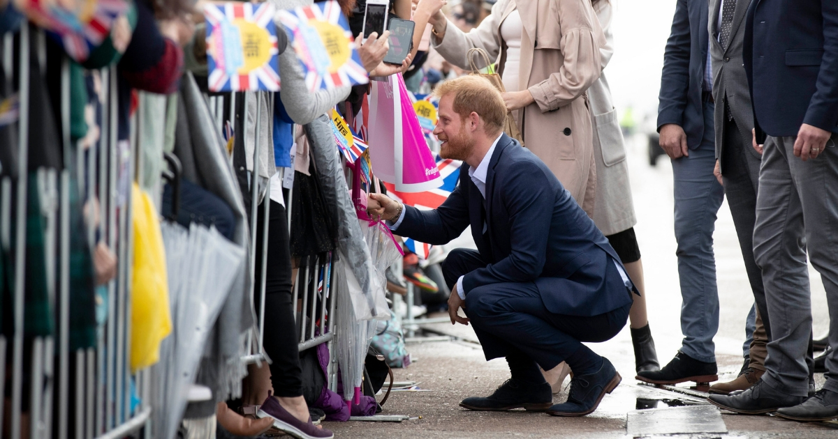 Prince Harry Kneels to Crowd