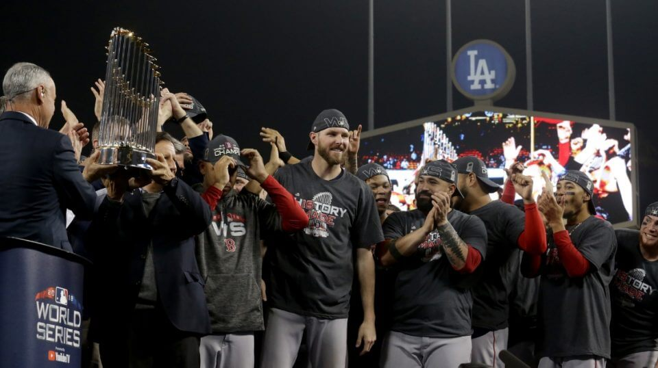 The Boston Red Sox celebrate with the World Series trophy after their 5-1 win over the Los Angeles Dodgers in Game 5 at Dodger Stadium on Sunday.
