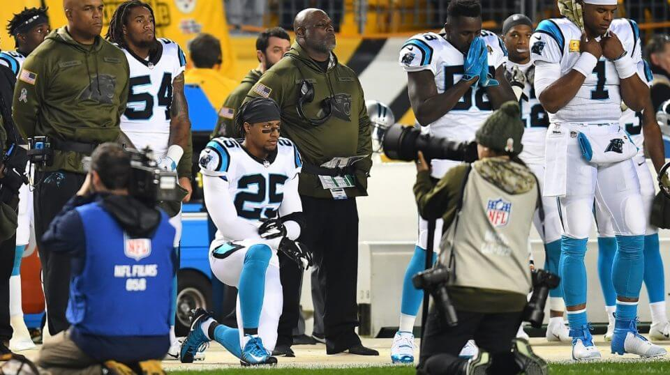 Eric Reid of the Carolina Panthers kneels in protest during the national anthem before Thursday night's game against the Pittsburgh Steelers at Heinz Field.