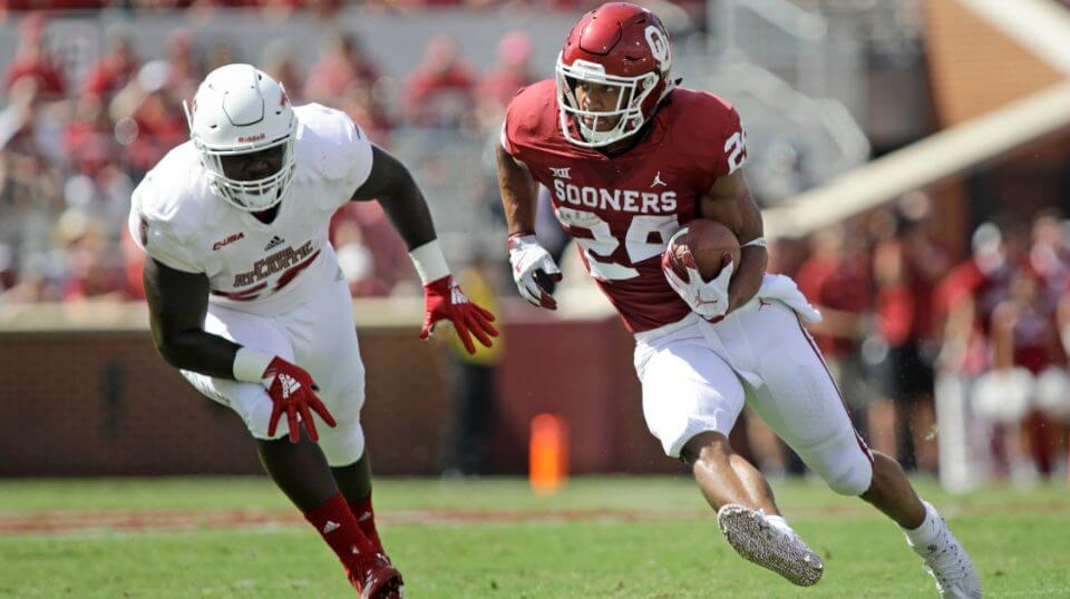 Running back Rodney Anderson of the Oklahoma Sooners cuts in front of a Florida Atlantic defender during a Sept. 1 game in Norman.
