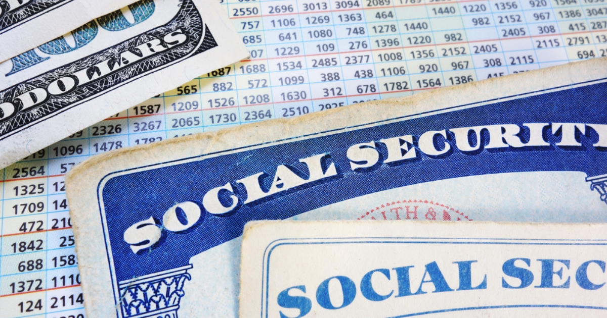 Social Security cards alongside a table of benefits