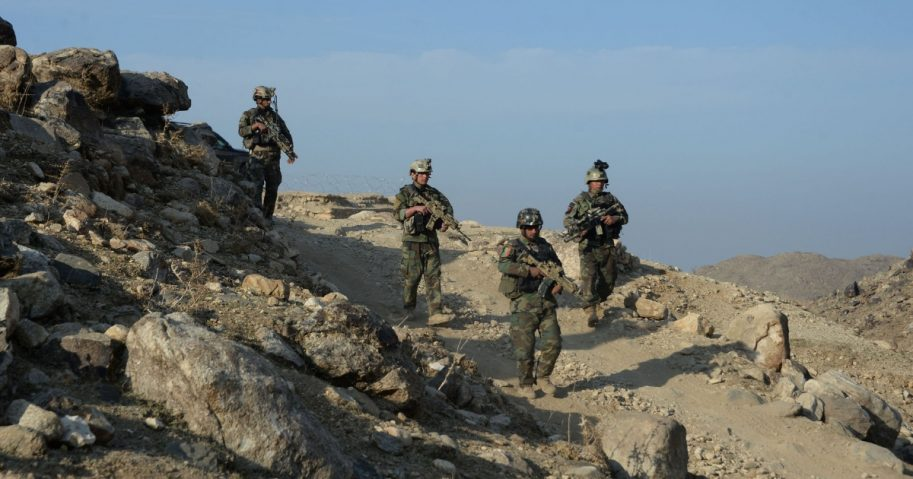 In this photograph taken on Jan. 3, 2018, Afghan commandos forces patrol during ongoing U.S.-Afghan military operation against Islamic State militants in Achin district of Nangarhar province.