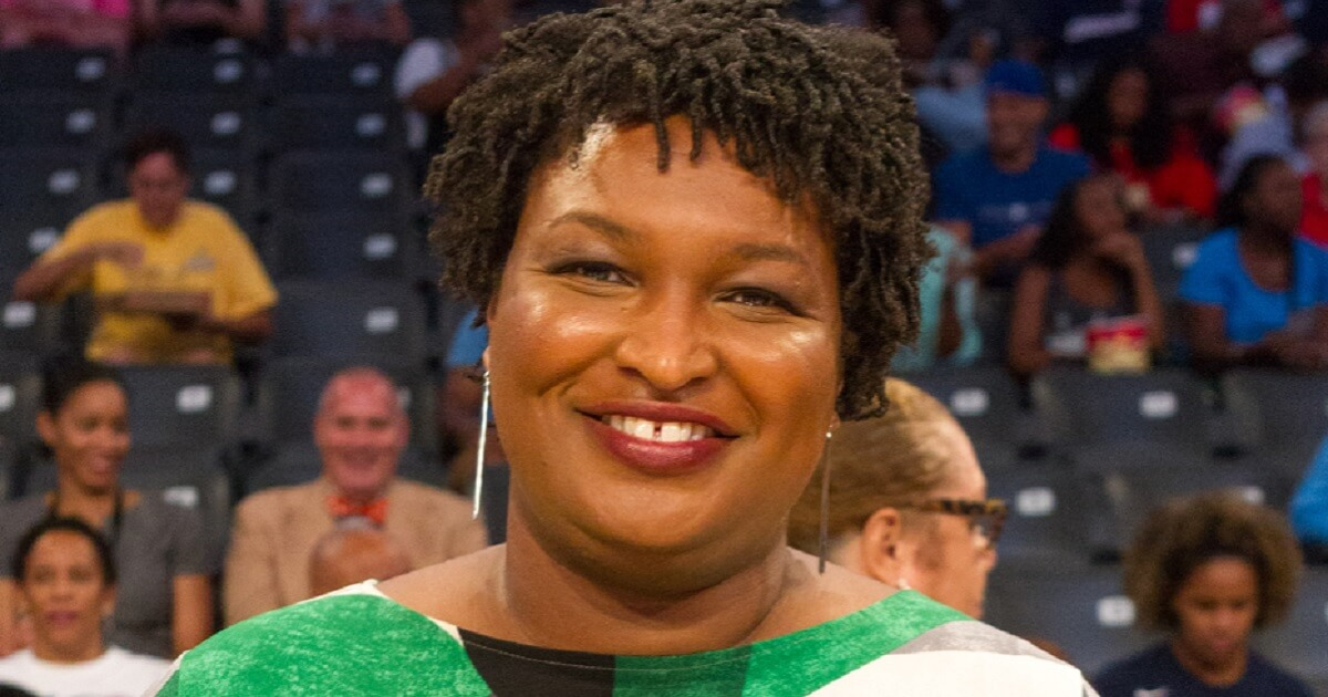 Stacey Abrams, Democratic candidate for governor,, smiles in an August photo.