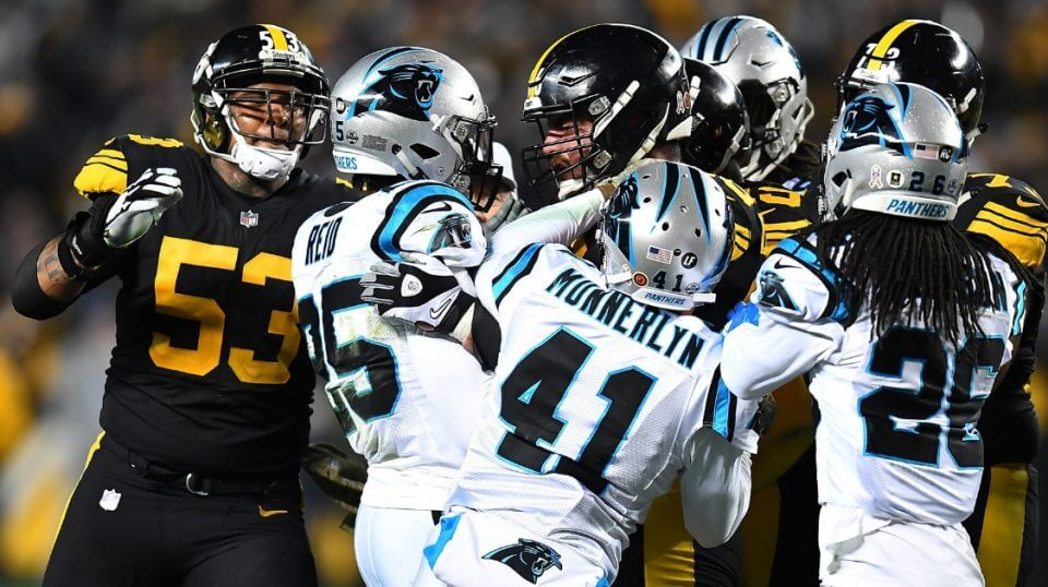 David DeCastro of the Pittsburgh Steelers shoves Eric Reid of the Carolina Panthers after a late hit on quarterback Ben Roethlisberger during their game Thursday night at Heinz Field.