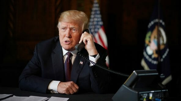 US President Donald Trump speaks to members of the military via teleconference