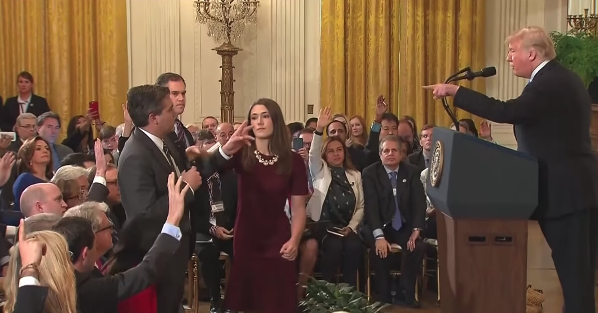 U.S. President Donald Trump spars with CNN's Jim Acosta during a news conference on Nov. 7, 2018.