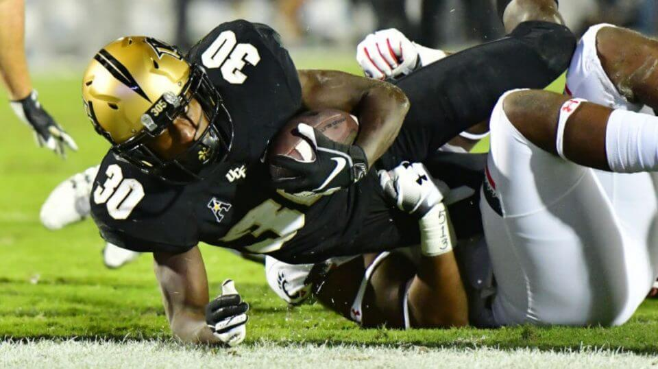 Greg McCrae of the UCF Knights stretches for a touchdown against the Cincinnati Bearcats on Saturday.