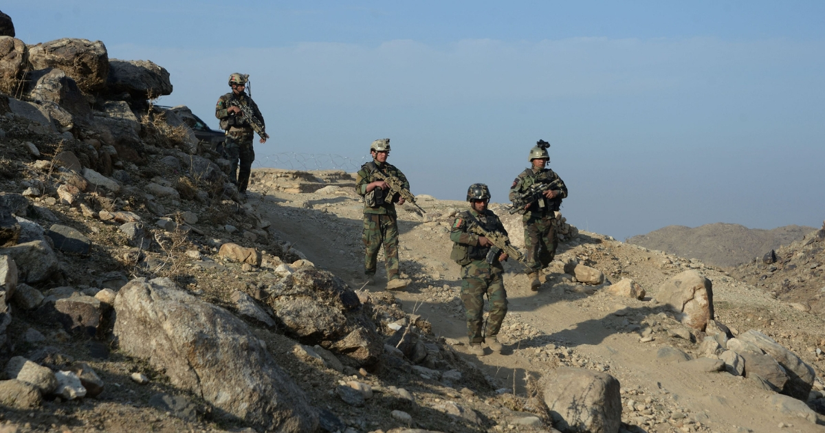 Afghan commandos forces patrol during ongoing U.S.-Afghan military operation against Islamic State militants in Achin district of Nangarhar province.