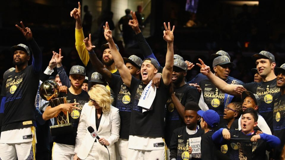 The Golden State Warriors celebrate June 8 after defeating the Cleveland Cavaliers in Game 4 to win their third NBA championship in four years.