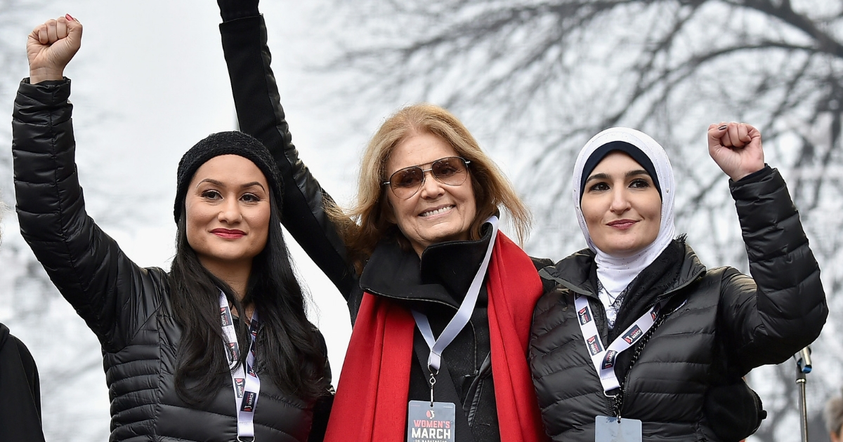 From left, Carmen Perez, Gloria Steinem and Linda Sarsour appear onstage Jan. 21, 2017, during the Women's March on Washington.