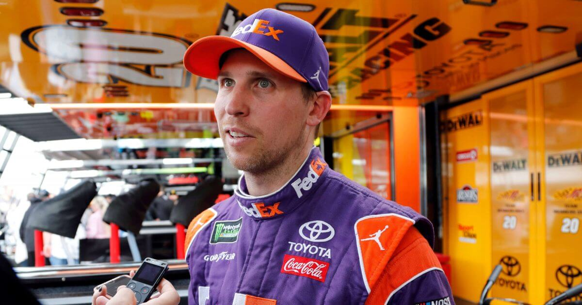 Denny Hamlin is interviewed after winning the pole position for Sunday's NASCAR season finale in Homestead, Florida.
