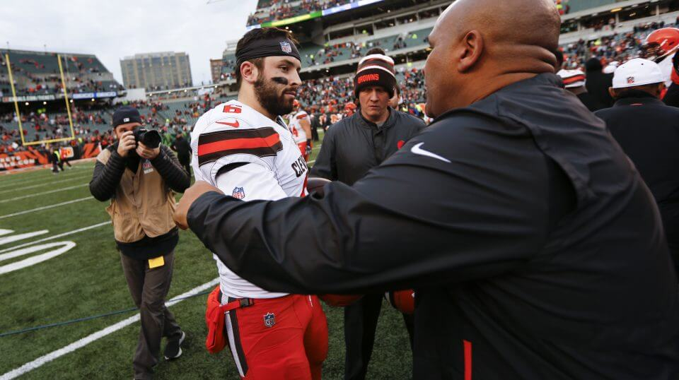 Cleveland quarterback Baker Mayfield meets with former Browns head coach and current Cincinnati Bengals special assistant Hue Jackson, right, after their game Sunday.