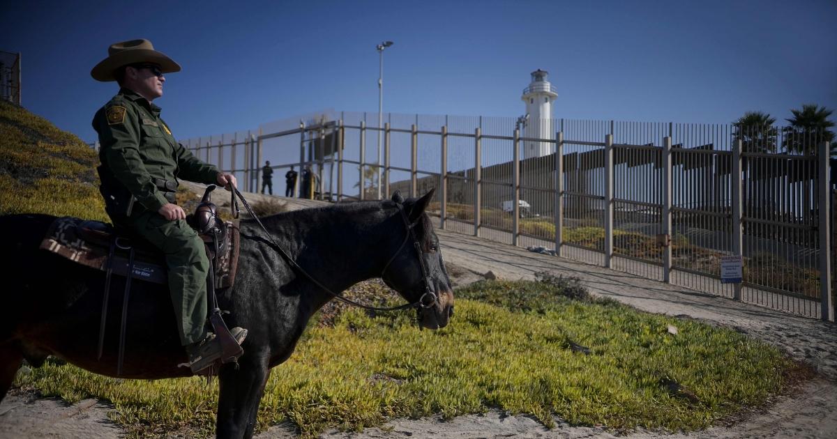 A Border patrol agent on horseback