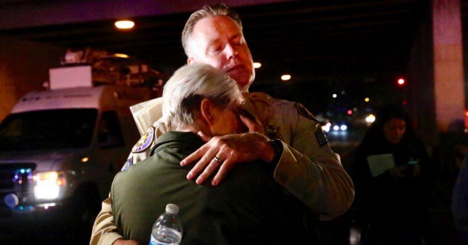 Ventura Co sheriff Sgt Eric Buschow hugs Sgt Julie Novak at the scene of mass shooting at Borderline Bar & Grill.