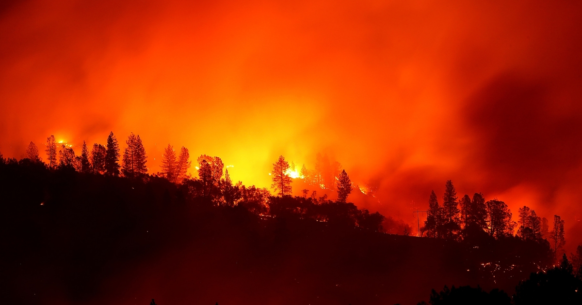 The Camp Fire burns in the hills on Nov. 11, 2018, near Oroville, California.