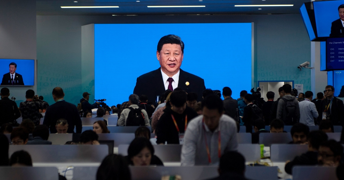 China's President Xi Jinping is seen on a big screen in the media center.