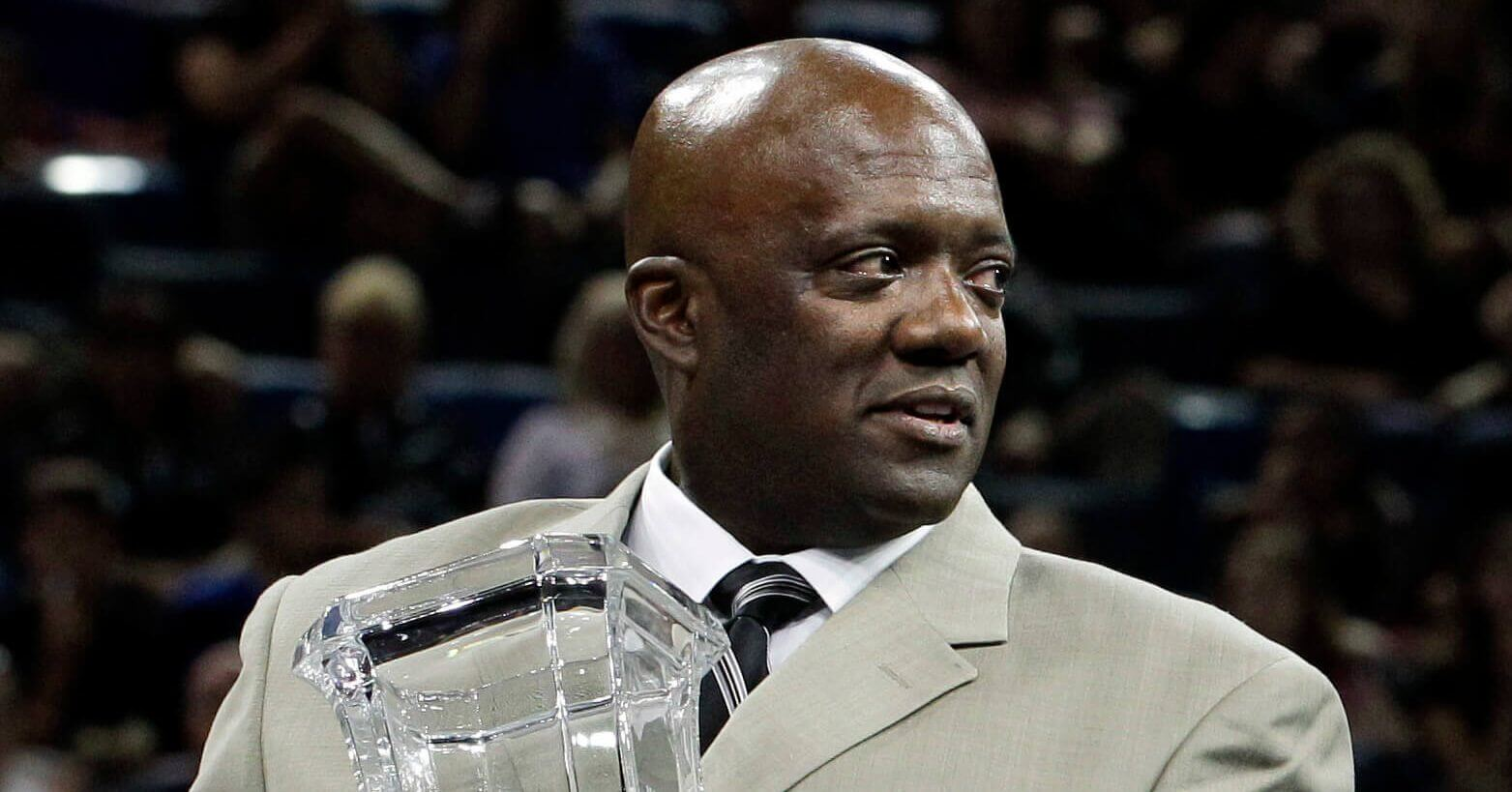 In this Aug. 14, 2010, file photo, Ron Galimore, a member of the 1980 Olympic gymnastics team that did not compete due to the U.S. boycott of the Olympic Games in Russia, is honored at the U.S. Gymnastics Championships in Hartford, Connecticut.