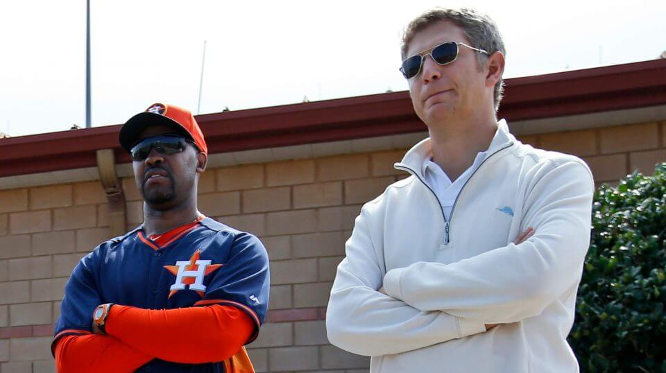 Then-Houston Astros manager Bo Porter, left, and scouting director Mike Elias stand together during a spring training baseball workout in Viera, Florida, in 2014.