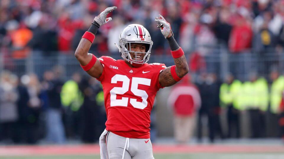 Ohio State defensive back Brendon White celebrates after making a tackle against Michigan on Saturday.