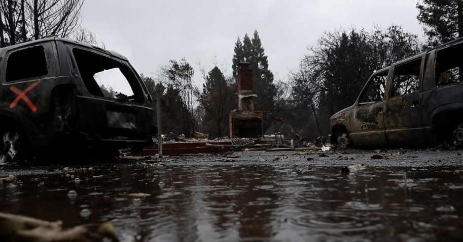 Rain falls on a home destroyed by the Camp Fire on November 22, 2018 in Paradise, California.