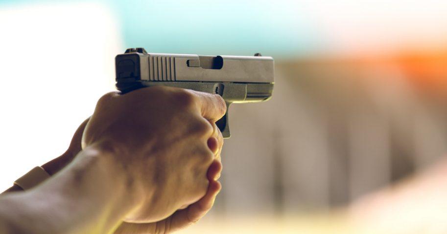 Man shooting hand gun.