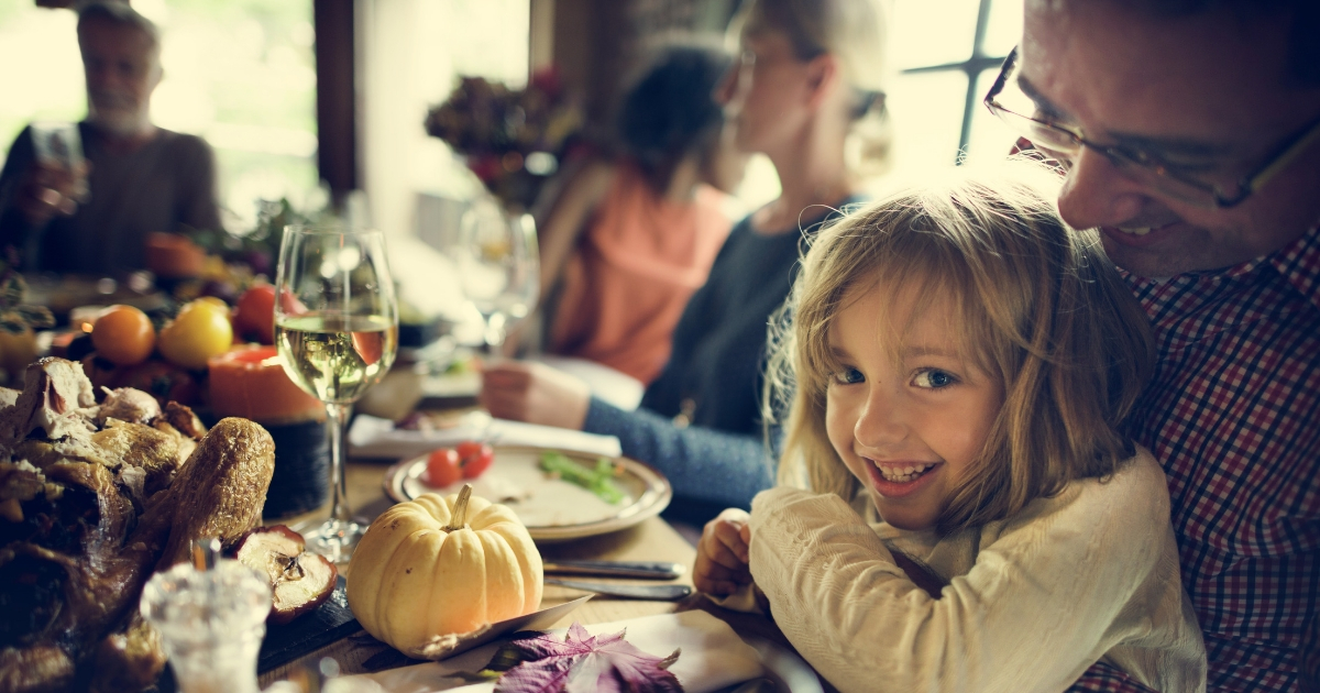 Little girl and her dad on Thanksgiving.