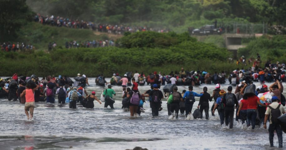 Salvadorean migrants heading in a caravan to the U.S., cross the Suchiate River to Mexico, as seen from Ciudad Tecun Uman, Guatemala, on Nov. 2, 2018.