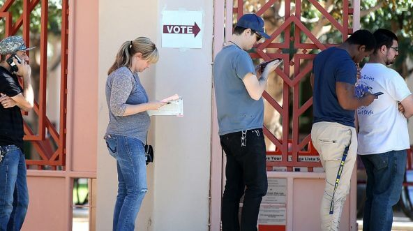 Arizona voters wait in line to cast their ballot at a polling place during the midterm elections on Nov. 6, 2018, in Phoenix, Arizona.
