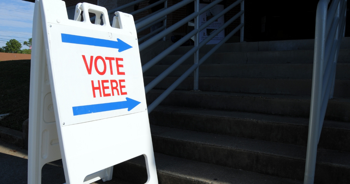 """""""Vote here"""" to direct voters to the polling place"""