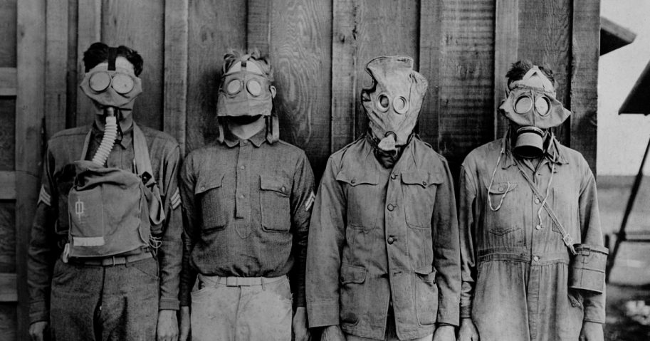 Soldiers wearing WWI gas masks