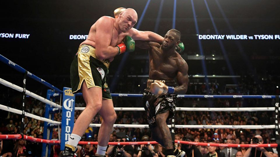 Deontay Wilder, right, connects with Tyson Fury, of England, during a WBC heavyweight championship boxing match Saturday in Los Angeles.
