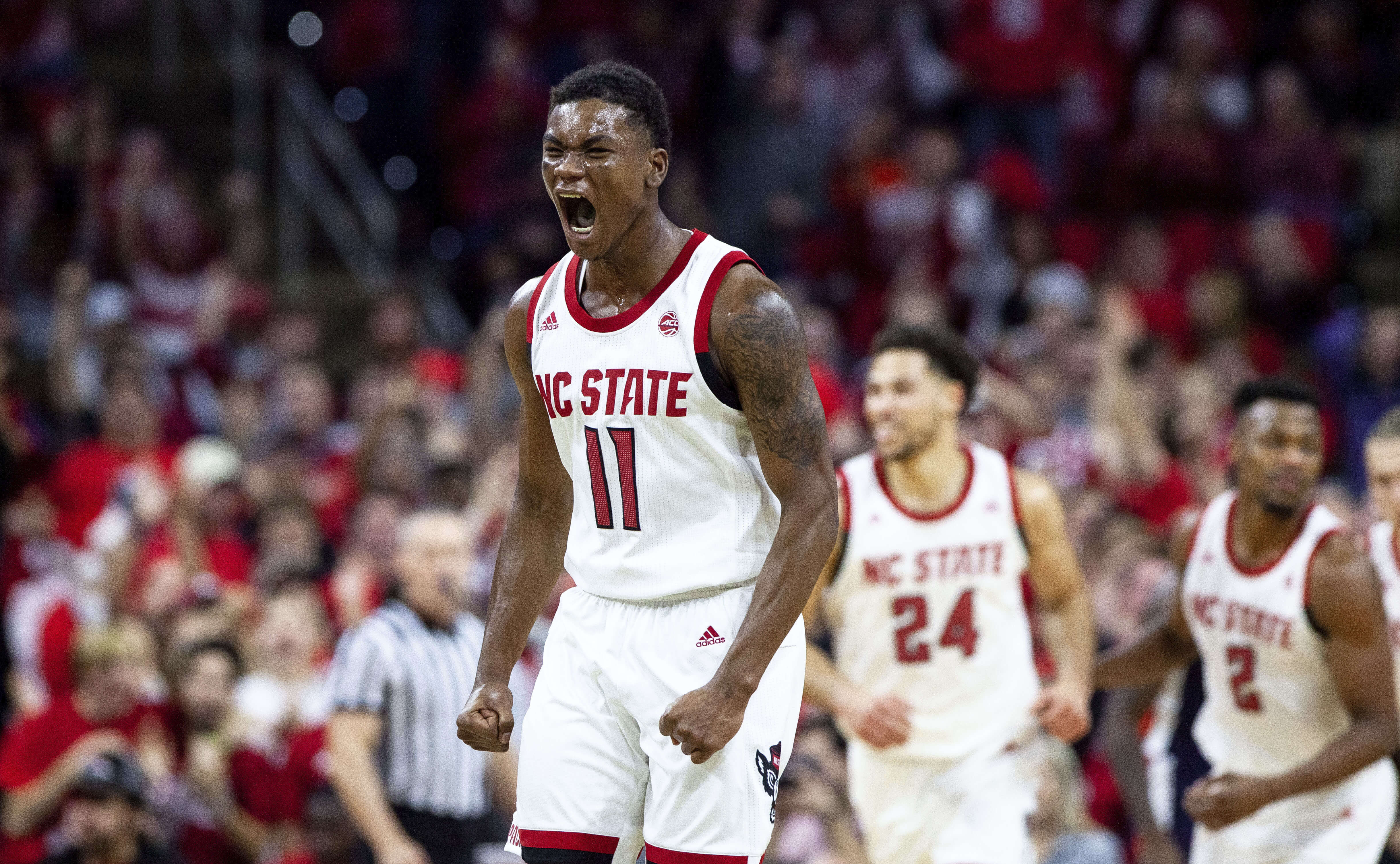 North Carolina State's Markell Johnson (11) reacts after hitting a 3-point shot during the second half against Auburn in Raleigh on Wednesday.