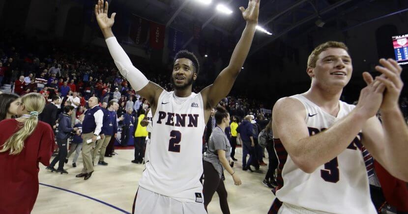 Penn's Antonio Woods (2) and Jake Silpe (3) celebrate after the Quakers beat Villanova 78-75 on Tuesday in Philadelphia.