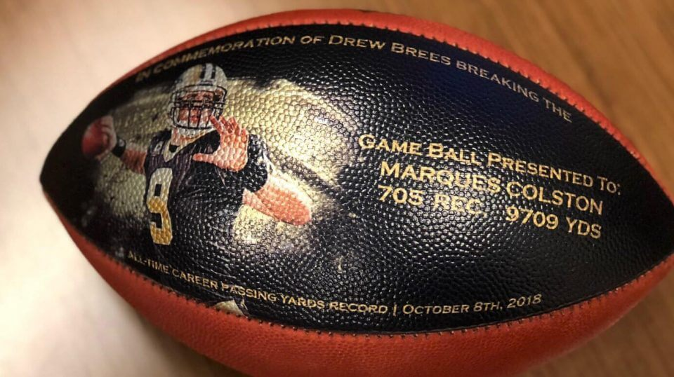 This undated photo provided by the New Orleans Saints shows a custom-made football. When Drew Brees became the NFL's all-time leader in yards passing, he wanted to thank everyone who helped him get there. His solution was an exhaustive process that involved the production of about 175 unique commemorative footballs and the enlisting Saints front office and public relations staff to help track down 99 receivers, 56 offensive linemen, 11 head or assistant coaches from his 18 pro seasons, as well as a few others Brees saw as instrumental in his success.