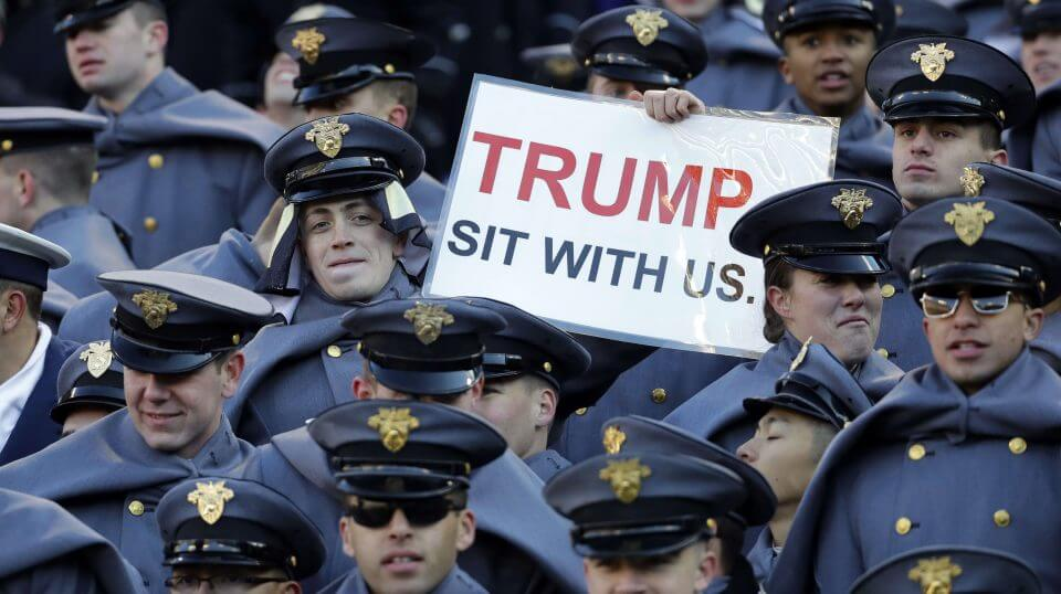 An Army cadet displays a sign for then President-elect Donald Trump during the 2016 Army-Navy game in Baltimore.