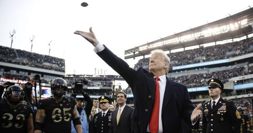 President Donald Trump tosses the coin before the Army-Navy football game Saturday in Philadelphia.