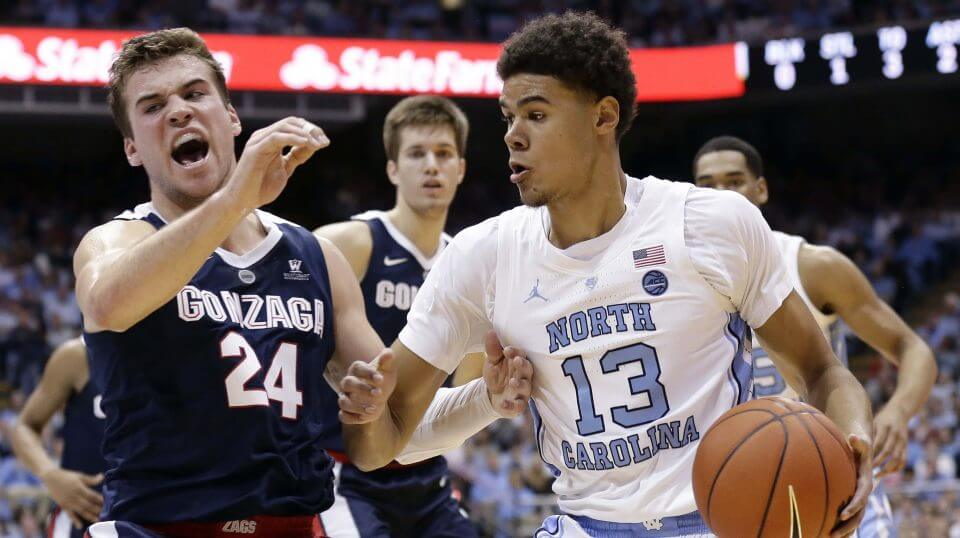 North Carolina's Cameron Johnson (13) dribbles the ball while Gonzaga's Corey Kispert (24) defends during the first half of an NCAA college basketball game in Chapel Hill, North Carolina, on Saturday.