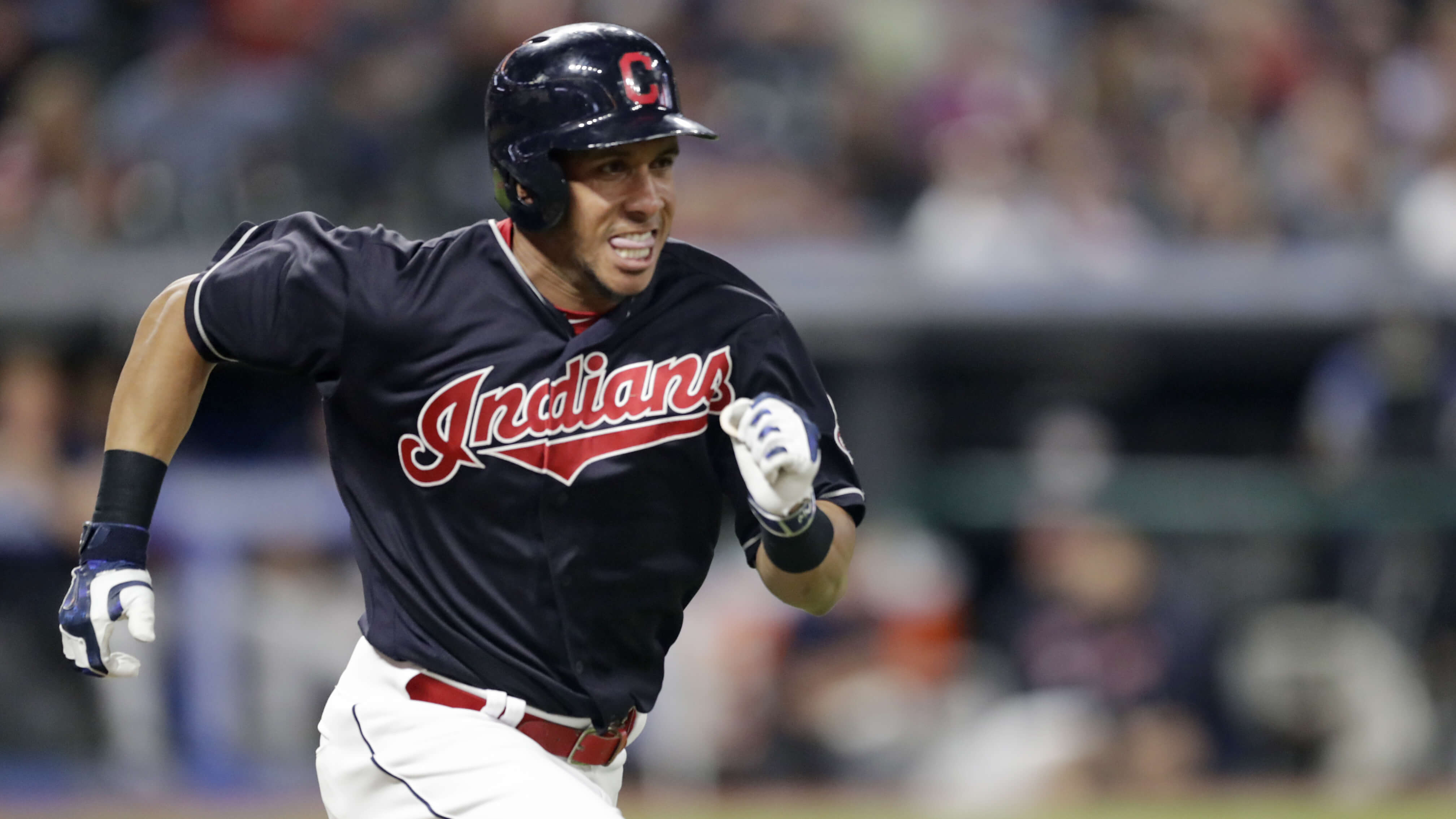 Michael Brantley runs to first base on a passed ball in the Indians' Sept. 19 game against the Chicago White Sox in Cleveland.