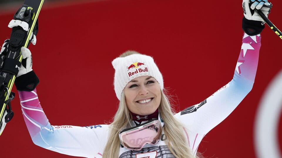 American skier Lindsey Vonn celebrates on the podium after winning an alpine ski, women's world Cup downhill race, in Garmisch Partenkirchen, Germany, on Feb. 4.