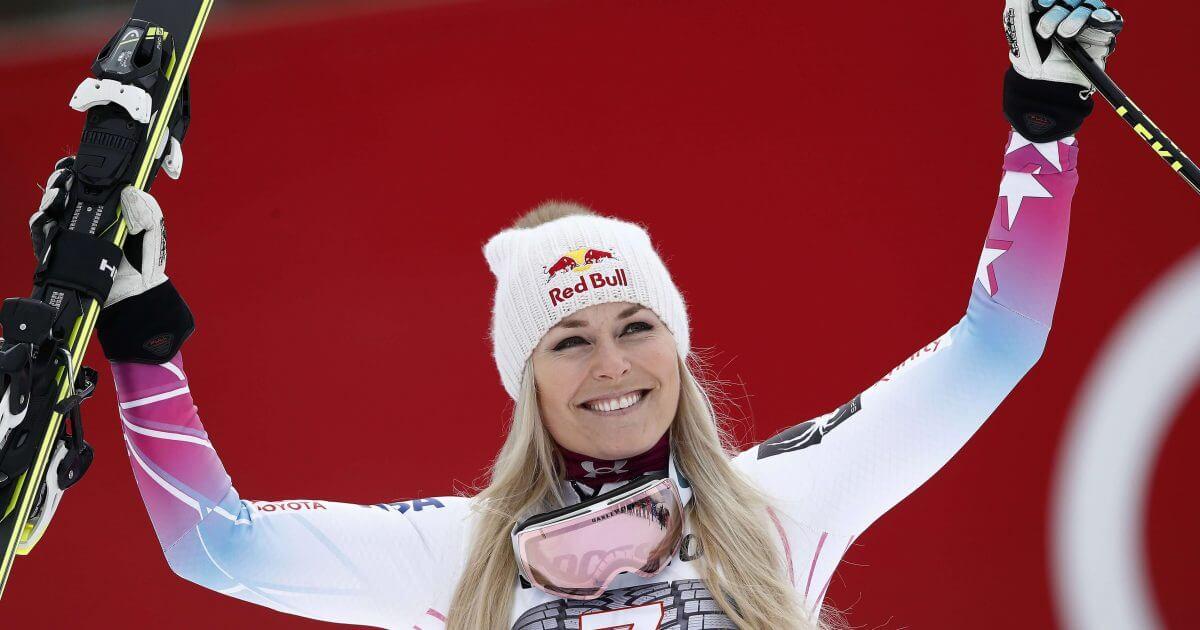 American skier Lindsey Vonn celebrates on the podium after winning an alpine ski, women's world Cup downhill race, in Garmisch Partenkirchen, Germany, on Feb. 4.