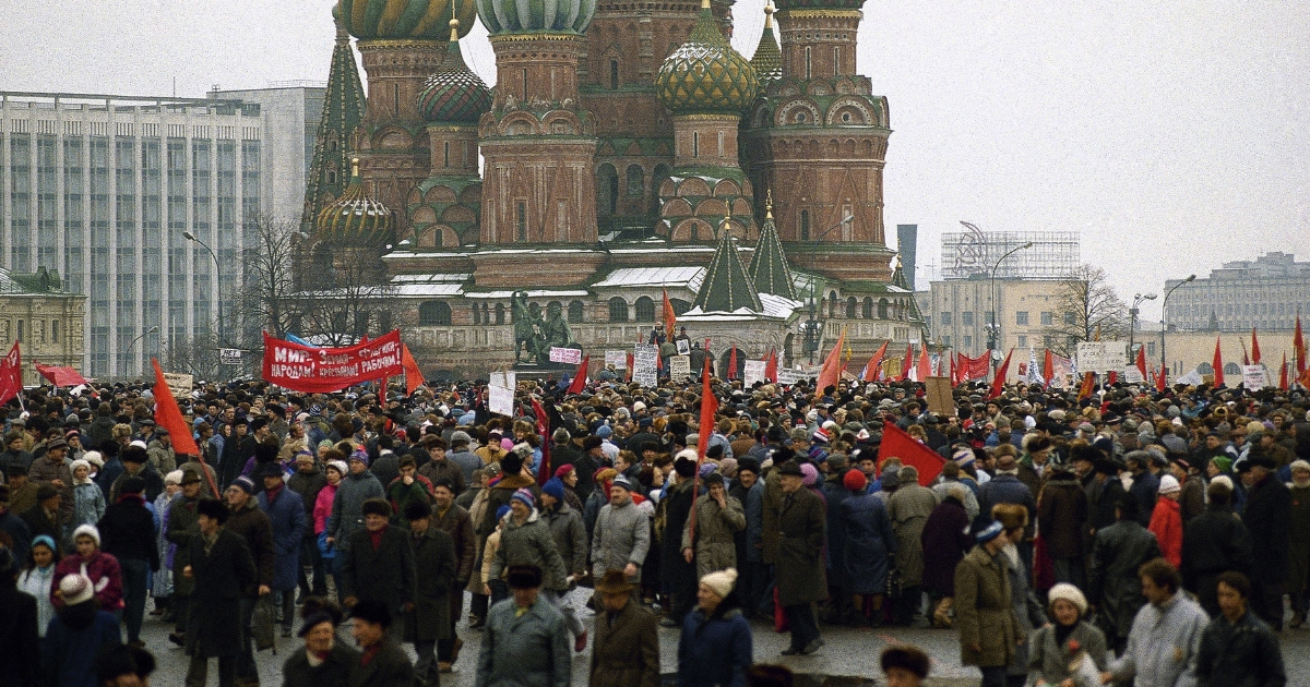 A few thousand Communist supporters loyal to Lenin's legacy gather on Red Square to mark the 74th anniversary of the Bolshevik Revolution, even though communism had fallen into disrepute in the Soviet Union and the government canceled the traditional military parade marking the anniversary on Nov. 7, 1990, in Moscow. In the background is St. Basil's Cathedral.